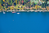 Boats moored up in Queenstown Harbour, South Island, New Zealand.