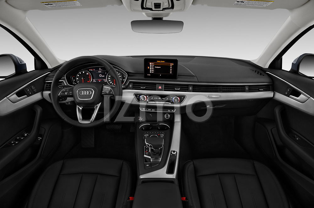 Stock photo of straight dashboard view of a 2018 Audi allroad Premium 5 Door Wagon