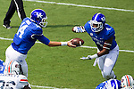 Kentucky Wildcats quarterback Patrick Towles (14) hands the ball to Kentucky Wildcats running back Mikel Horton (4) as Kentucky beats UT Martin 59-14 in Commonwealth Stadium on August 30, 2014.  Photo by Mark Mahan