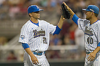 UCLA pitcher Nick Vander Tuig (21) is greeted by teammate Ryan Deeter (40) during the 2013 Men's College World Series Final on June 25, 2013 at TD Ameritrade Park in Omaha, Nebraska. The Bruins defeated the Mississippi State Bulldogs 8-0, winning the National Championship. (Andrew Woolley/Four Seam Images)