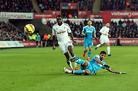 SWANSEA, WALES - FEBRUARY 07: Patrick Van Aanholt of Sunderland (R) gets the ball away from Nathan Dyer of Swansea during the Premier League match between Swansea City and Sunderland AFC at Liberty Stadium on February 7, 2015 in Swansea, Wales.