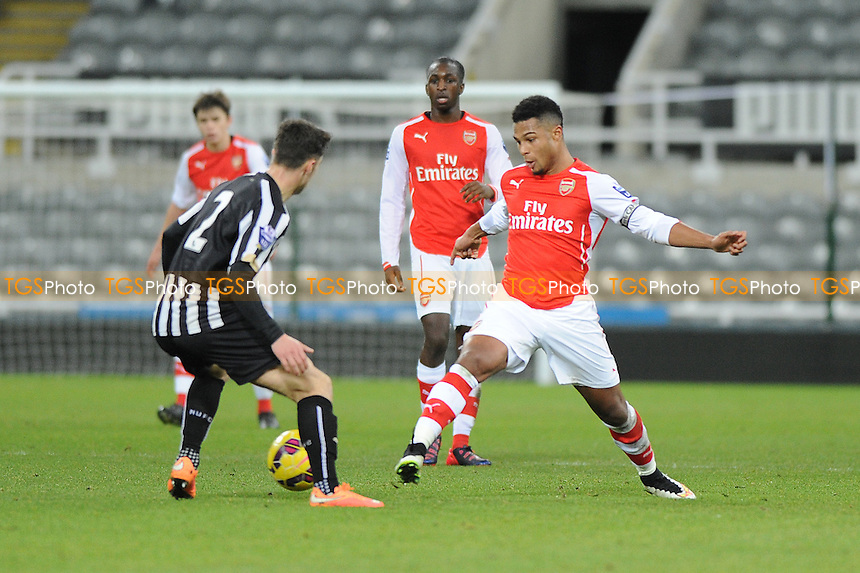 Serge Gnabry of Arsenal battles with Jamie Sterry of Newcastle United - Newcastle United Under-21 vs Arsenal Under-21 - Barclays Under-21 Premier League Football at St James Park, Newcastle United FC - 09/02/15 - MANDATORY CREDIT: Steven White/TGSPHOTO - Self billing applies where appropriate - contact@tgsphoto.co.uk - NO UNPAID USE