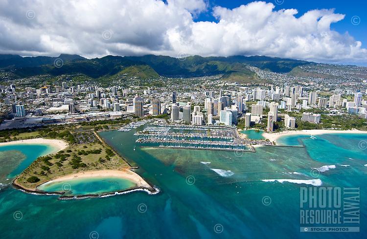 Aerial of Ala Moana beach park and magic island with Ala Wai harbor, Oahu