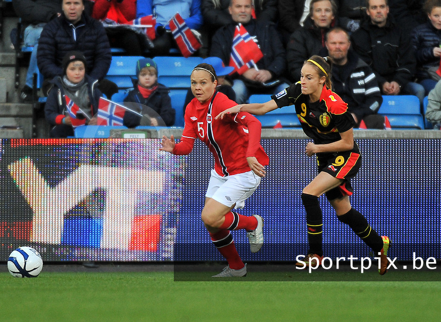 20130925 - OSLO , NORWAY : Norwegian Toril Akerhaugen (5) pictured with Belgian Tessa Wullaert during the female soccer match between Norway and Belgium , on the second matchday in group 5 of the UEFA qualifying round to the FIFA Women World Cup in Canada 2015 at the Ullevaal Stadion , Oslo . Wednesday 25th September 2013. PHOTO DAVID CATRY