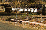 Row of silver metal mail boxes in a Mother Lode town, Calif.