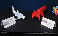 Origami by Children display at the OrigamiUSA 2013 Convention. Blue shark folded by Douglas Morton, 15, Connecticut, designed by John Montroll. Fox folded by Daniel Ventura, 10, Rhode Island, designed by John Montroll.