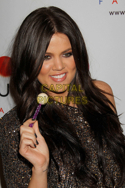 KHLOE KARDASHIAN.Mel B's Sugar Factory Couture Lollipop Series Launch Party at Guys and Dolls Lounge, West Hollywood, California, USA..January 19th, 2010.headshot portrait sequins sequined bronze gold beads beaded sweet candy.CAP/ADM/MJ.©Michael Jade/AdMedia/Capital Pictures.