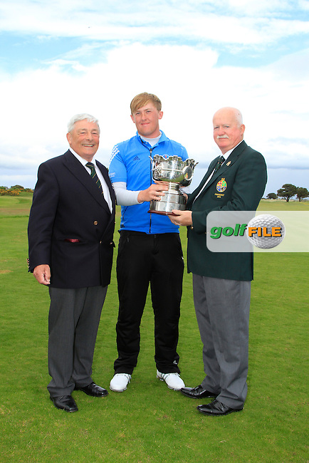 Liam Martin (President G.U.I) and Enda McDermott (Captain The Royal Dublin GC) with Jamie Savage (SCO) winner of the The Irish Amateur Open Championship in The Royal Dublin Golf Club on Sunday 11th May 2014.<br /> Picture:  Thos Caffrey / www.golffile.ie