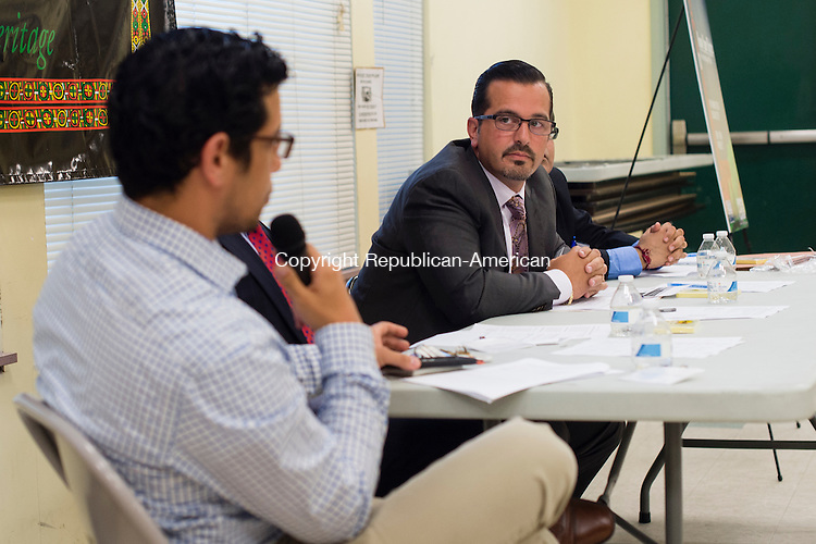 """WATERBURY, CT- 30 August 2016-083016EC09-   Ioannis """"John"""" Kaloidis, a Waterbury defense attorney, answered questions from attendees at the WOW Community Learning Center along Walnut Street in Waterbury. Melvin Medina, an outreach coordinator for the Connecticut ACLU, (far left) moderated the event. Tuesday night's forum was intended to inform residents what actions are within their rights when interacting with police. Erin Covey Republican-American"""