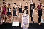 Fashion designer Angela Friedman posing in front of the models wearing her Angela Friedman lingerie collection during the inaugural Wear New York Fashion Week presentation at 393 Broadway on June 27, 2013.