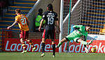 Craig Tanner slots the ball under Partick Thistle goalkeeper Tomas Cerny to score the second goal