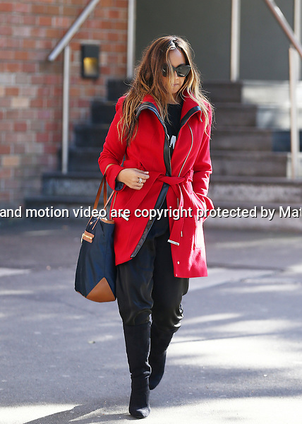 7 JULY 2014 SYDNEY AUSTRALIA<br /> <br /> EXCLUSIVE PICTURES<br /> <br /> Jessica Mauboy pictured leaving her Surry Hills apartment dressed in a striking red coat for some appointments and a visit to Sony Music.<br /> <br /> *No internet without clearance*.<br /> MUST CALL PRIOR TO USE <br /> +61 2 9211-1088. <br /> <br /> Matrix Media Group.Note: All editorial images subject to the following: For editorial use only. Additional clearance required for commercial, wireless, internet or promotional use.Images may not be altered or modified. Matrix Media Group makes no representations or warranties regarding names, trademarks or logos appearing in the images.