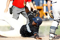 15 July 2011: Fred Hanvi of the Senart Templiers slides safely into home plate during the 2011 Challenge de France match won 6-5 by the Rouen Huskies over the Senart Templiers at Stade Pierre Rolland, in Rouen, France.