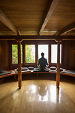 USA, California, Big Sur, Esalen, a man sits and performs a sitting meditation in the Meditation Center at the Esalen Institute