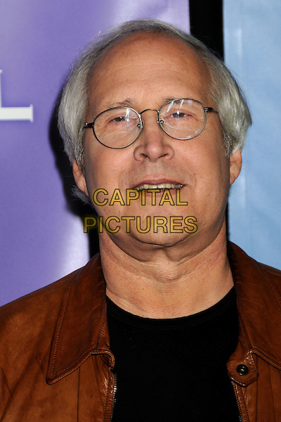 CHEVY CHASE .NBC Universal Press Tour Cocktail Party held at the Langham Hotel, Pasadena, California, USA, 10th January 2010..portrait headshot glasses tan brown leather .CAP/ADM/BP.©Byron Purvis/AdMedia/Capital Pictures.