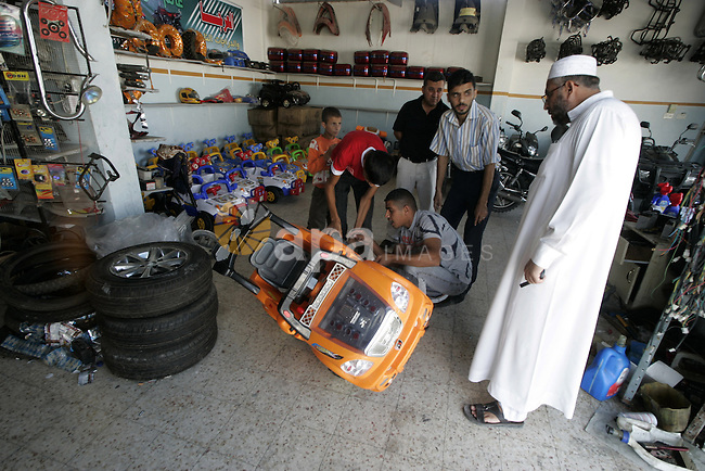 A Palestinian man sells cars running in a remote control.The cars smuggled through underground tunnels between Egypt and Gaza, the price of 700 shekels per car in Rafah, southern Gaza Strip on Sep 28, 2009.The Gaza Strip, under a tight blockade from Israel since Islamist Hamas seized power in the enclave in 2007, relies on international aid and products smuggled through a network of tunnels linking it to Egyp. Photo By Abed Rahim Khatib