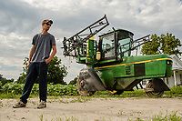 Farmer Adam Bundy, 25, (CQ) poses for a portrait on a tobacco farm in Dudley, NC on Tuesday, June 27, 2017. (Justin Cook for The Guardian)