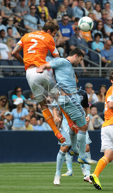 Football - Major League Soccer - Houston Dynamo at Sporting KC - The Sporting KC and the Houston Dynamo played to a 1-1 tie in regulation time at Sporting KC Park in Kansas City, Kansas, USA. Houston Dynamo defender Eric Brunner (2) and Sporting KC forward Claudio Bieler (16) leap for a header in the first half.