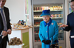 © Joel Goodman - 07973 332324 . No syndication permitted . 14/11/2013 . Manchester , UK . The Queen explores the canteen . Queen Elizabeth II and the Duke of Edinburgh visit the Coop building at 1 Angel Square , Manchester , this morning ( 14th November 2013 ) . Photo credit : Joel Goodman