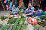 Women sell vegetables in the Tahan Market in Kalay, a town in Myanmar. This market is located in Tahan, the largely ethnic Chin section of the town. They have thanaka, a cosmetic paste, on their faces.