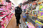 NHP Trooper Albert Sevier II shops with a local student at the 11th annual Holiday with a Hero at Walmart in Carson City, Nev., on Wednesday, Dec. 16, 2015. <br /> Photo by Cathleen Allison
