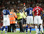 The referee gives the red card to a streaker as Manchester United play Inter Milan. Pic SPORTIMAGE/Dave Thompson..Pre-Season Friendly..Manchester United v Internazionale..1st August, 2007..--------------------..Sportimage +44 7980659747..admin@sportimage.co.uk..http://www.sportimage.co.uk/