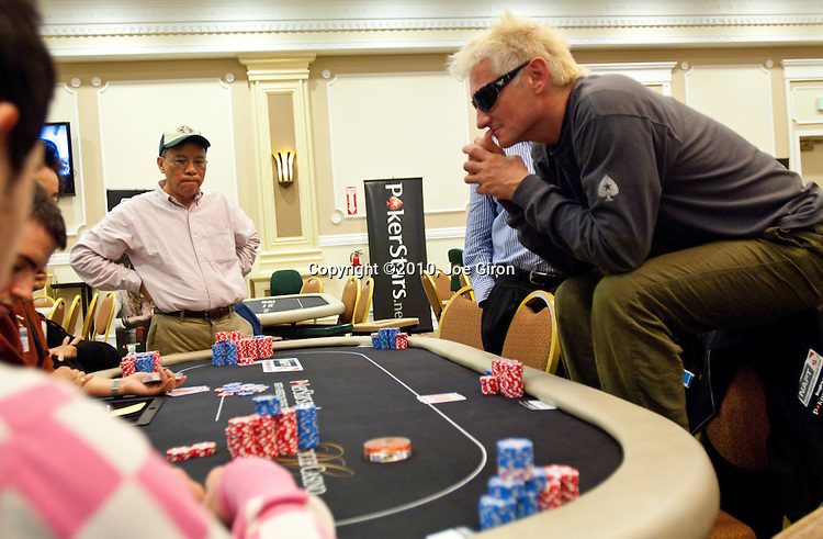 Tom Lee, left, and Niko Deininger, right are in a hand against  Thomas Young, foreground.