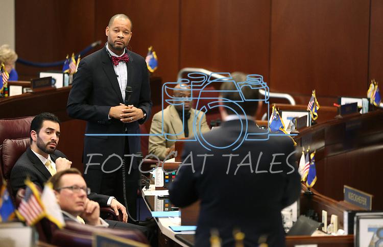 Nevada Senate Minority Leader Aaron Ford, D-Las Vegas, and Majority Leader Michael Roberson, R-Las Vegas, debate on the Senate floor at the Legislative Building, in Carson City, Nev., on Friday, Feb. 20, 2015. <br /> Photo by Cathleen Allison
