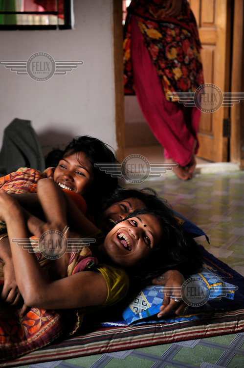 Girls laugh together at a shelter for prostitutes run by the local NGO SEEP, which is supported by Dutch NGO Terre des Hommes. The young women mostly work through the night and come to the shelter in the morning to sleep, eat and receive counselling.