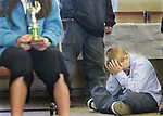 MICHAEL SMITH/WTE.Cole Elementary student Joe Girone, 10, reacts during the award ceremony for the Laramie County School District 1 spelling bee at the LCSD 1 administration building Wednesday morning.