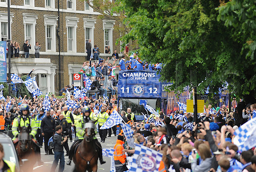20.05.2012 Chelsea London, England..Champions League Cup Winners Parade atop the traditional open-top bus to the Stamford Bridge Ground. Picture shows the crowded streets and police security