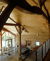 Although plywood, concrete and cement have beenused liberally in its conversion, the barn has retained much of its original DNA such as brick walls and huge beams