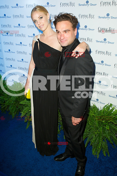 WASHINGTON, DC - APRIL 28:  Johnny Galecki and guest  attends Capital File magazine's WHCAD After - Party hosted by Claire Danes at The Newseum in Washington, D.C  on April 28th, 2012  ( Photo by Chaz Niell/Media Punch Inc.)