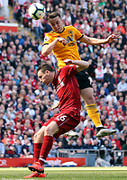 Wolverhampton Wanderers' Diogo Jota directs a headed effort towards goal despite the attentions of Liverpool's Andrew Robertson<br /> <br /> Photographer Rich Linley/CameraSport<br /> <br /> The Premier League - Liverpool v Wolverhampton Wanderers - Sunday 12th May 2019 - Anfield - Liverpool<br /> <br /> World Copyright © 2019 CameraSport. All rights reserved. 43 Linden Ave. Countesthorpe. Leicester. England. LE8 5PG - Tel: +44 (0) 116 277 4147 - admin@camerasport.com - www.camerasport.com