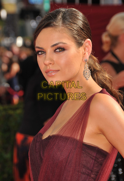 MILA KUNIS.Arrivals at the 61st Annual Primetime Emmy Awards held at NOKIA Theatre L.A. LIVE, Los Angeles, California, USA..September 20th, 2009.headshot portrait red maroon burgundy emmys sheer dangling silver earring.CAP/ADM/BP.©Byron Purvis/AdMedia/Capital Pictures.