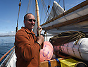 THE BESSIE ELLEN TRAVEL FEATURE.<br /> The crew lower the sails off the island of Lunga in the Inner Hebrides, Scotland.<br /> Conservation officer, James Hilgemann, 54.<br /> Photo:Clare Kendall<br /> 24/05/2016