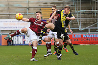 Marc Richards of Northampton Town beats Andy Parrish of Morecambe to the ball during the Sky Bet League 2 match between Northampton Town and Morecambe at Sixfields Stadium, Northampton, England on 23 January 2016. Photo by David Horn / PRiME Media Images.