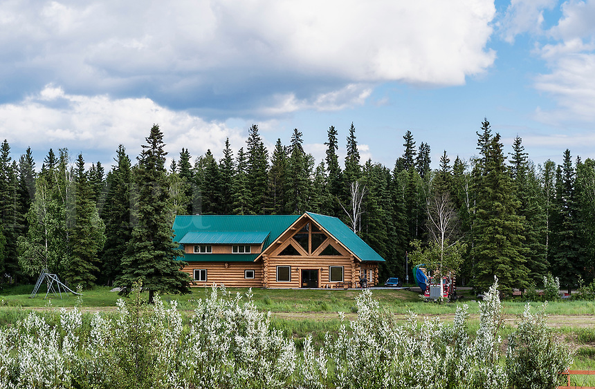 Modern log cabin home on the bankof the China River, Fairbanks, Alaska, USA