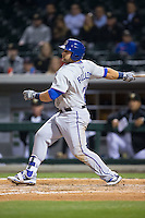 Kyle Roller (21) of the Durham Bulls follows through on his swing against the Charlotte Knights at BB&T BallPark on April 14, 2016 in Charlotte, North Carolina.  The Bulls defeated the Knights 2-0.  (Brian Westerholt/Four Seam Images)