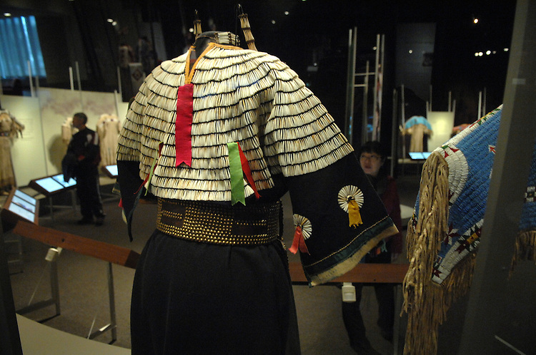 Native American dresses are on display at the National Museum of the American Indian with the Identity by Design exhibit.  This picture shows the back of a Sioux cloth dress from South Dakota, circa 1900.