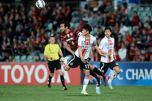 07.04.2015. Sydney, Australia. AFC Champions League. Western Sydney Wanderers v FC Seoul. Wanderers captain Topor-Stanley wins the ball from Seoul midfielder Yun Il-lok.
