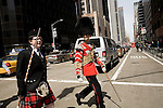 Saturday, April 14,  2007, New York, New York.. The 9th annual Tartan Day Parade was held today on 6th Avenue between 44th and 58th Streets.. Thousands turned out to play the drums, pipes and to view all those dressed for the occasion.. Andrew Symon, of Scotland, and Tom Belyea, of Boston, cross 6th Avenue to meet up with their band.