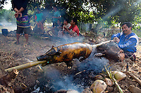 September 9th 2007- Bali, Indonesia- In preparation for a wedding, men roast a pig over an open fire in an area known as Jemeluk Bay, which is located near the Amed area of North East Bali. Photograph by Daniel J. Groshong/Tayo Photo Group