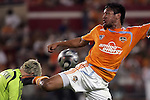 10 November 2007:  Brian Ching (25) of the Houston Dynamo misses the ball and kicks Kevin Hartman (l) goalie of the Wizards, in the neck.  The MLS Houston Dynamo defeated the Kansas City Wizards 2-0 at Robertson Stadium, Houston, Texas to capture the 2007 MLS Western Conference title and to advance to the MLS Cup championship final on Saturday, November 18th.