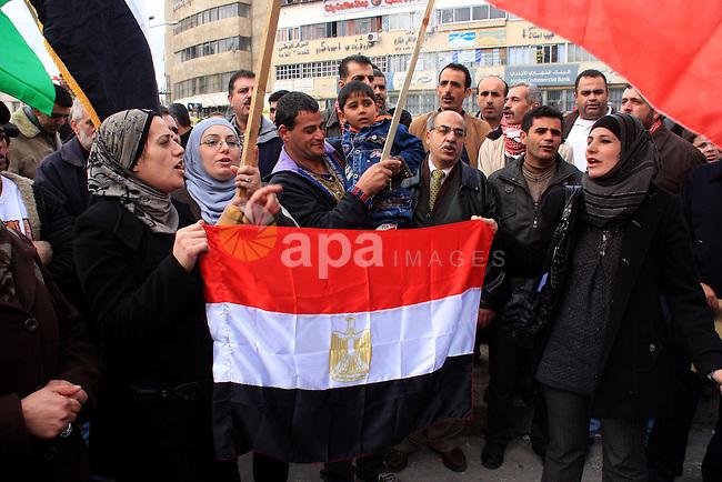 Palestinians celebrate Egyptian President Hosni Mubarak's resignation, in the West Bank city of Nablus, Saturday, Feb. 12 , 2011. Photo by Wagdi Eshtayah