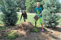 "NWA Democrat-Gazette/MICHAEL WOODS • @NWAMICHAELW<br /> Woodland Junior High 7th graders Gracie Benham (from left) and Gabe Lee help spread mulch around the plants at the ""Garden of Infinite Spirit"" Tuesday September 1, 2015 at Woodland Junior High School in Fayetteville.  The garden, designed by  landscape artist David Slawson, is part of a new outdoor classroom area built in memory of two Woodland teachers, Becky Knight and Jane Coomes, who recently passed away."