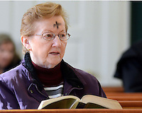 DOYLESTOWN, PA - FEBRUARY 18: Rosemary Flaherty, of Doylestown, Pennsylvania sits in a pew with a prayer book after receiving ashes on her forehead for Ash Wednesday at Our Lady of Mt. Carmel Catholic Church February 18, 2015 in Doylestown, Pennsylvania. (Photo by William Thomas Cain/Cain Images)