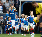 Rangers captain Lee Wallace leads out the mascots