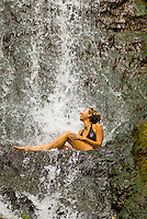 A beautiful 23 year old young woman experiences the thrill of Likeke Falls, a waterfall nestled in the Koolau mountains near Pali Lookout on Oahu's windward side.