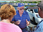 Candid activity at the Blue Sky Farms & Winery booth, at the Saugerties Farmer's Market on Main Street in the Village of Saugerties, NY, on Saturday, June 10, 2017. Photo by Jim Peppler. Copyright/Jim Peppler-2017.